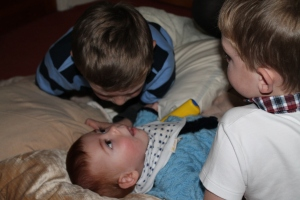 Bonding with his cousins aged 8 months!